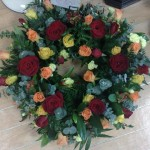 loose wreath with roses hydes florist doncaster funeral flowers
