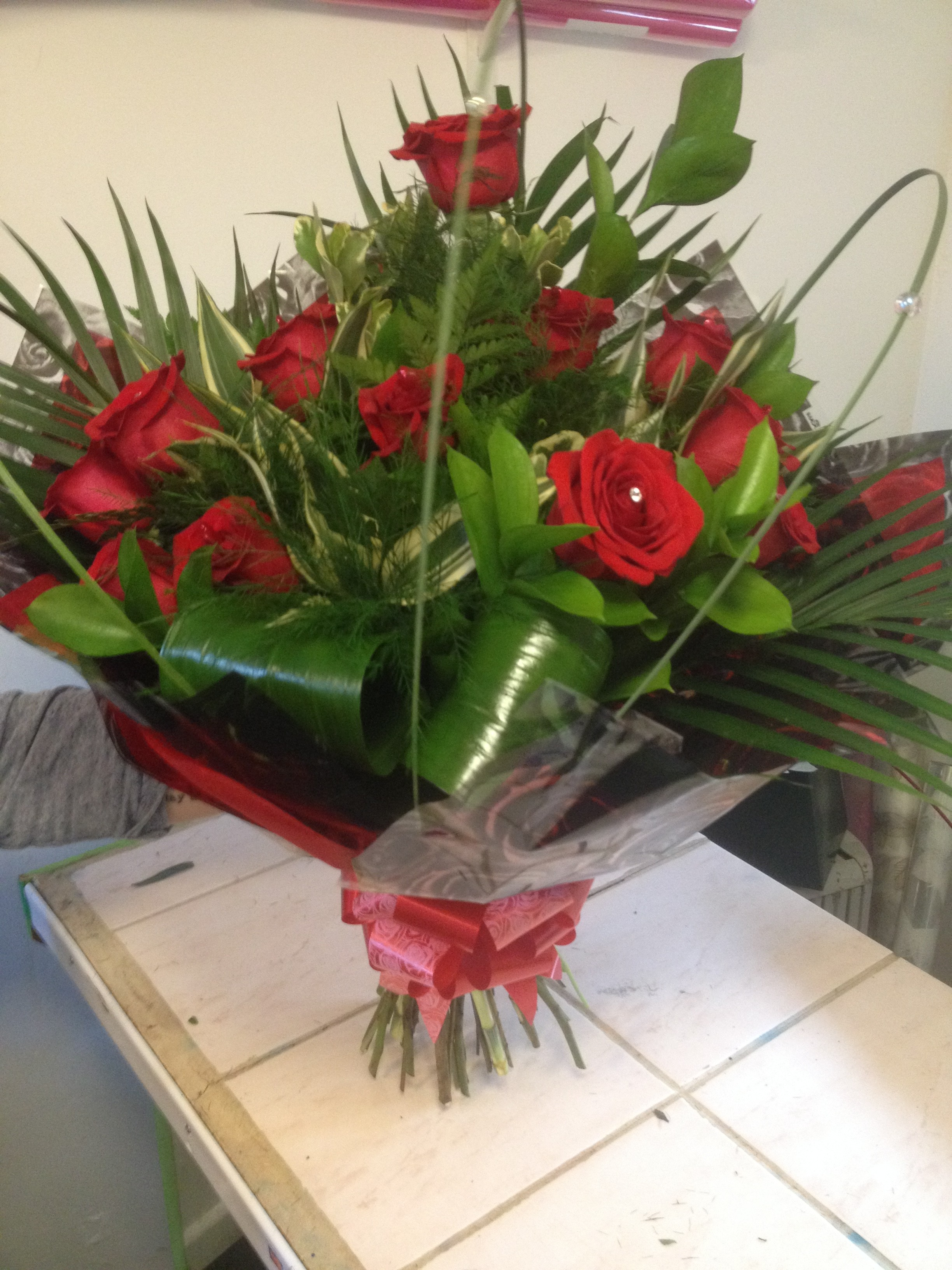 12 red roses hand tied bouquet