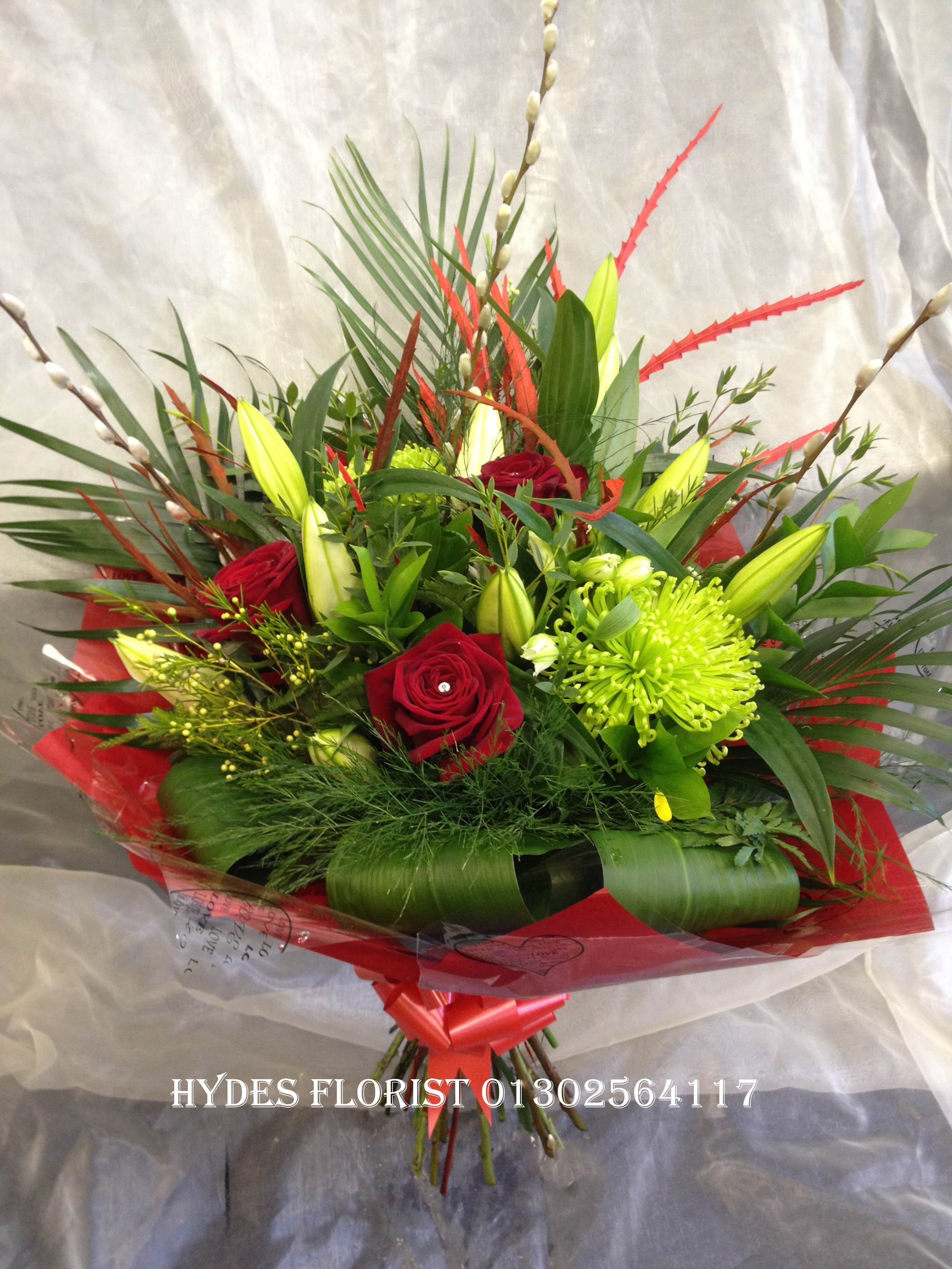 luxury handtied bouquet with lillies and single red rose