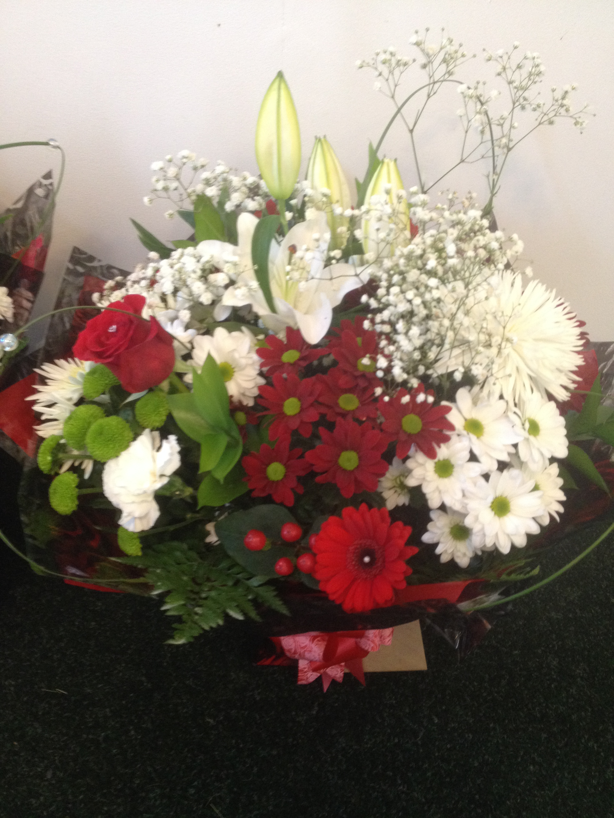 hand tied bouquet with single red rose