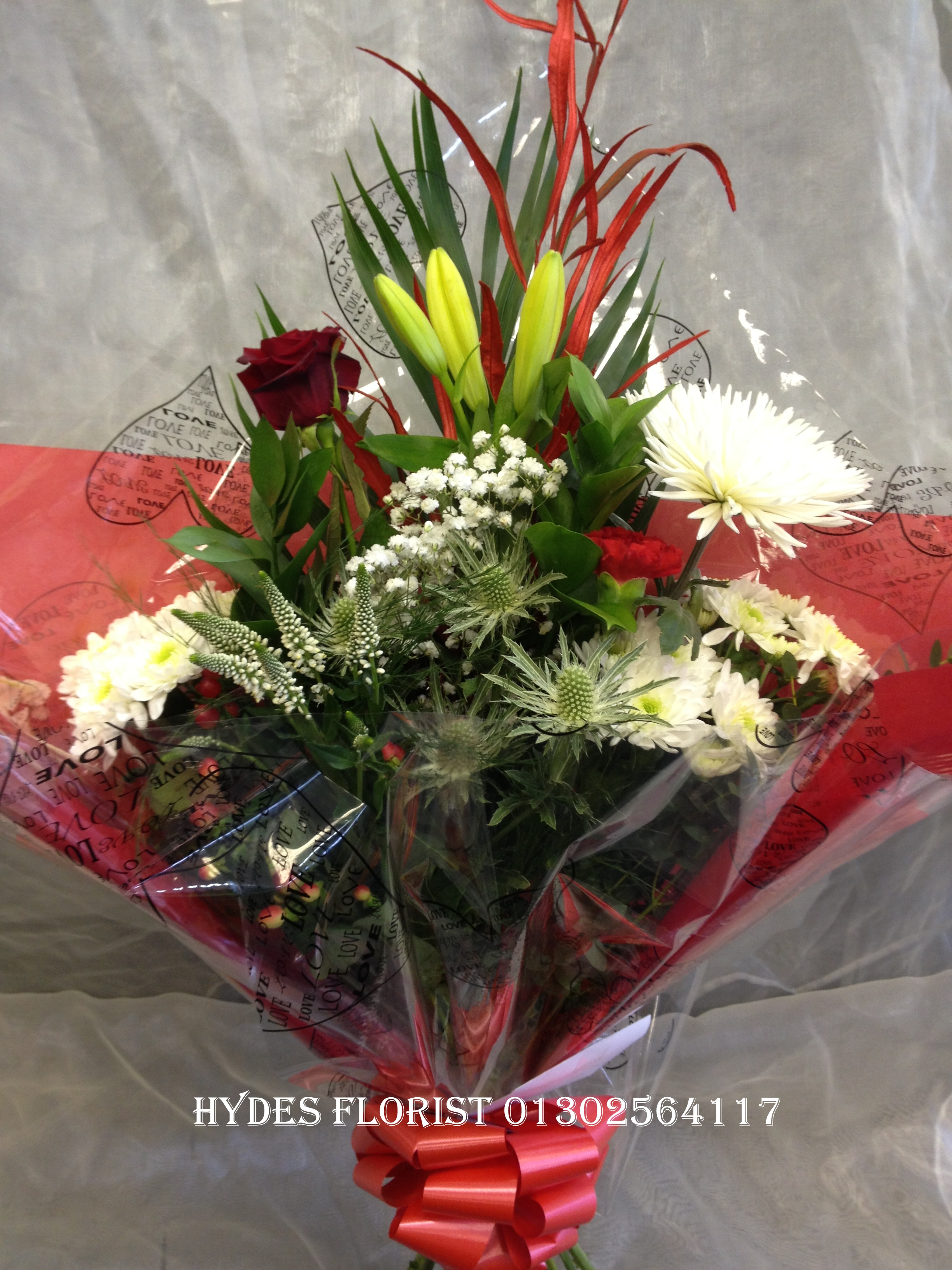 traditional bouquet with single red rose