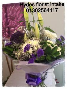 purple handtied bouquet   £35