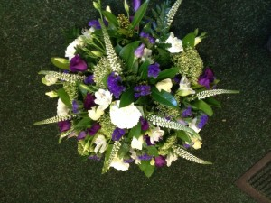 white and purple posy From £25
